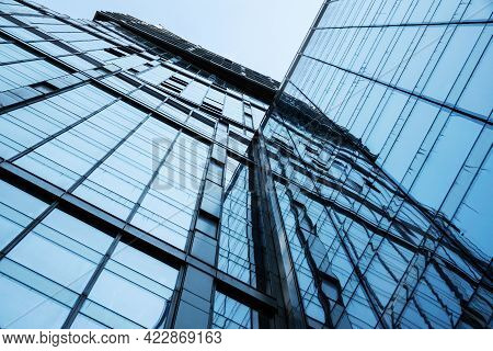 Moscow, Russia - April 13, 2021: Abstract Bottom View Of A Modern Glass Building With Reflections An