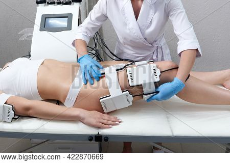 Beautiful Woman Getting Electro Stimulation Therapy. Laser Lipo Equipment. Cosmetic Fat Reduce Treat