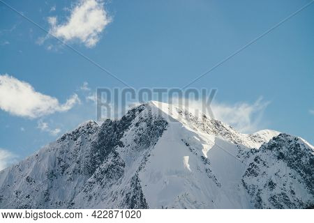 Great View To High Snowy Mountain Peaked Top With Low Cloud Under Cirrus Clouds In Sky. Low Clouds O