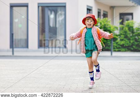 Cute Little Preschool Girl Going To Playschool. Healthy Toddler Child Walking To Nursery School And