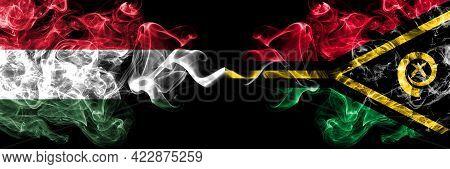 Hungary, Hungarian Vs Vanuatu Smoky Flags Side By Side.