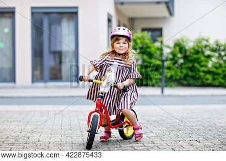 Little Toddler Girl Running With Balance Bike On Summer Day. Happy Child Driving, Biking With Bicycl