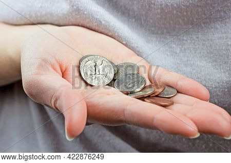 Caucasian Woman Hand Holding And Counting Usa Coin Cents. Unemployment, Poverty, Savings And Budget