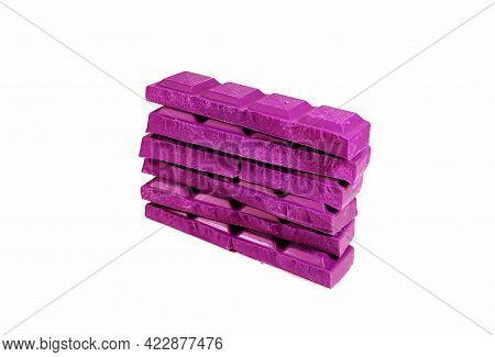 Pop Art Style Hot Pink Colored Stack Of Chocolate Chunks Isolated On White Background