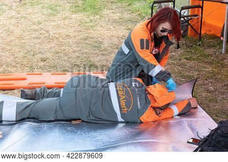 May 22, 2021, Russia, Moscow. Liza Alert Rescuers Demonstrate Work With The Injured Man. The Man Is