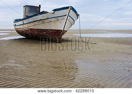 Stranded foshing boat