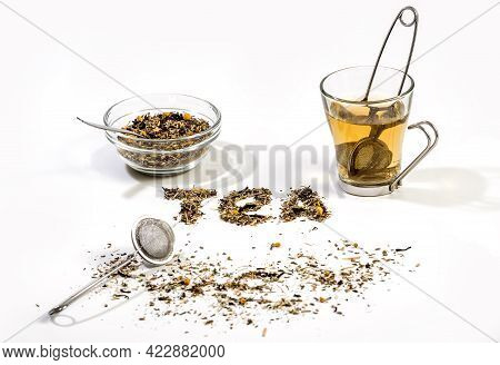 Tea Text Made By Tea Leaf On Wwhite Background Surface With A Bowl Of Tea And Small Glass Tea Cup