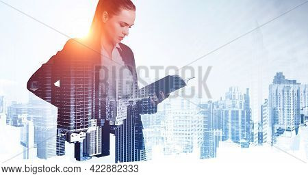 Office Woman In Black Suit Serious Look, Analysing Journal In Hands. Business Buildings Toned Image,