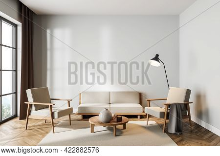 Modern Living Room Interior With Two Chairs And Sofa On Parquet Floor, Lamp And Window. Minimalist R