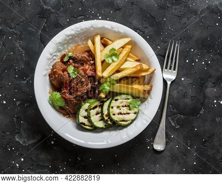 Slow Cooker Beef Stew With Grilled Zucchini And French Fries On A Dark Background, Top View