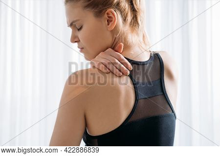 Exercise Therapy. Neck Pain. Sport Injury Trauma. Disturbed Woman In Activewear Suffering From Backa