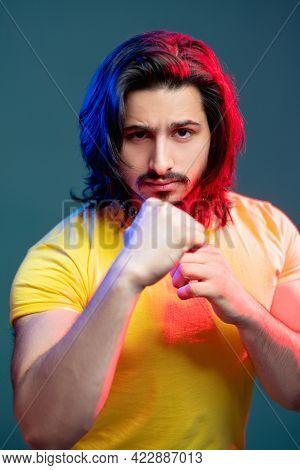 Macho Strong Man. Masculine Power. Fashion Portrait. Neon Light People. Confident Guy Yellow T-shirt