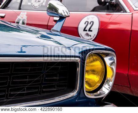 Retro Car Festival. Retro Car Headlight. Fragment Of The Front Of A Retro Car. The Old Car Has Been