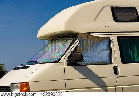Camper Van With Internal Thermal Screen Blind At Window Pane Camping On Nature In Summer. Traveling