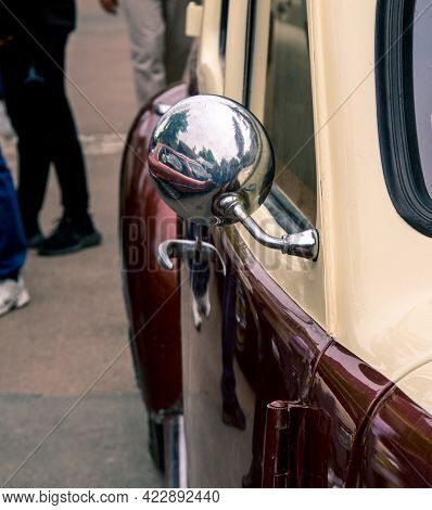 Retro Car Festival. Rearview Mirror On An Old Retro Car . Fragment Of The Front Of A Retro Car. The