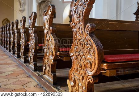 Empty Pews Inside Church Close-up, Carved Wooden Pews In Catholic Cathedral, Detail Of Christian Chu