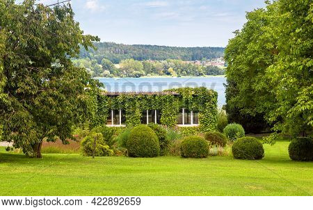 Landscape Design With Plants And Flowers At House In Reichenau Island, Germany. Nice Landscaping Hom