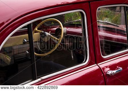 Retro Car Festival. View Of The Windshield And Steering Wheel On An Old Retro Car. Fragment Of The F