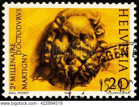 Moscow, Russia - June 06, 2021: Stamp Printed In Switzerland Shows Gallo-roman Capital Sculpture, De