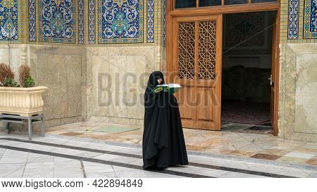 Shrine Of Fatima Masumeh, Qom, Iran - May 2019: Iranian Religious Woman Praying Inside Shrine Of Fat