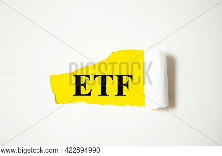 Exchange Traded Funds The Text Is Written On A White Background And A Yellow Piece Of Paper. Text