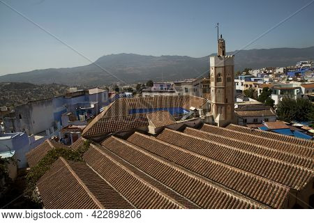 Chefchaouen, Morocco. 24 September 2017. View Of The Minaret And The Tiled Roofs Of Grand Mosque (el