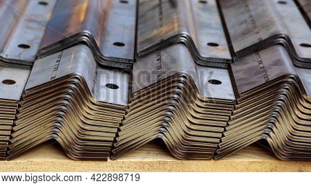 A Stack Of Sheet Metal Products After Processing On A Bending Machine.