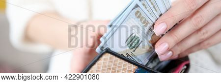 Womans Hand Takes Out American Banknotes From Wallet