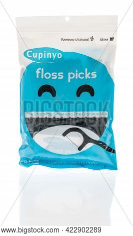 Winneconne, Wi - 29 May 2021:  A Package Of Cupinyo Dental Floss Picks On An Isolated Background