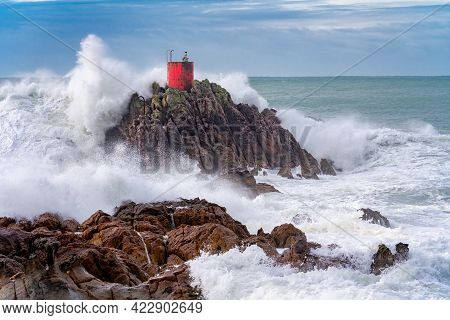Dramatic Storm Waves Smashing And Splashing Around North Rock And It's Red Beacon At Mount Maunganui