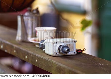 Softly Focused Shallow Depth Of Field Objects Including An Old Tap Timer And Crockery