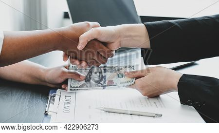 Hands Shaking After Government Officials Receiving Bribe Money From Businesswoman, The Concept Of Co