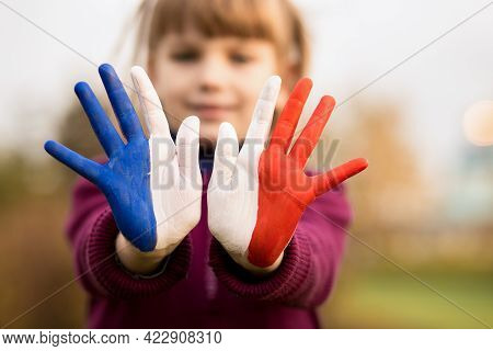 Joyful Girl Waving Hands Painted In France Flag Colors And Say Hello Outdoor At Sunset Background