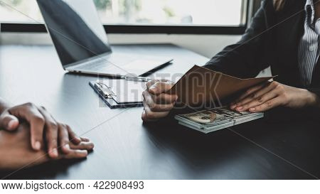 Businesswoman Hand Holding Bribe Money To Government Officials Sign Contracts For Business Projects,