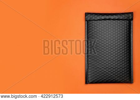 Padded Envelope With Bubble Wrap On Orange Background, Top View. Space For Text
