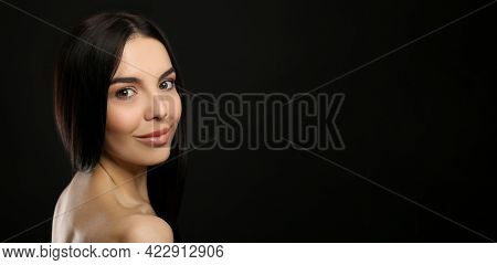 Portrait Of Happy Young Woman With Beautiful Black Hair And Charming Smile On Dark Background, Space