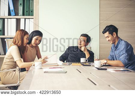Happiness Diversity Business Team Meeting Corporate Office Desk In Company Meeting Room. Asian Team