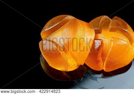 Two Beautiful Yellow Marmalade Candy On A Dark Background.