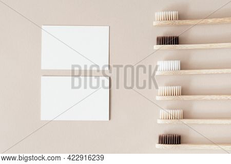 Bamboo toothbrushes and white blank cards