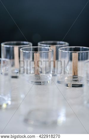 Glass Glasses With Wicks Are On The Table.
