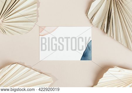 Business cards with dried palm leaves mockup