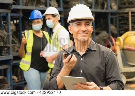 Men And Women Work Together, Use Walkie-talkie And Smile. Caucasian Engineer Man Use Table And Smile
