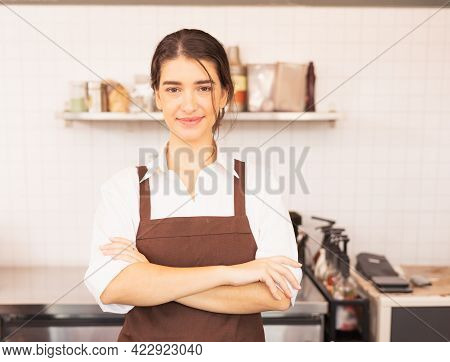 Beautiful Caucasian Barista Woman Stands With Crossed Arms To Welcome Customers At Coffee Bar In Caf