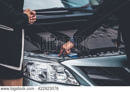 Man Help Woman Fix The Car Problem. He Pop Up The Car Hood To Repair The Damaged Part.