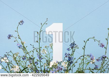 Number One Among Blue Flowers On Blue Background. Birthday, Anniversary, Jubilee Concept. For Invita