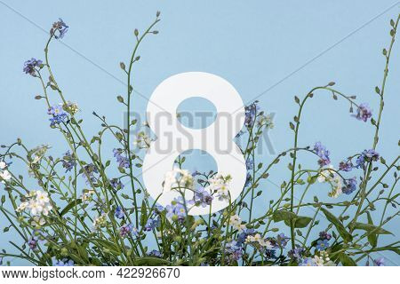 Number Eight Among Blue Flowers On Blue Background. Birthday, Anniversary, Jubilee Concept. For Invi