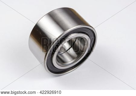 Hub Bearing On White Background. New Silver Front Hub Bearing Of The Car. Auto Parts, Consumables.