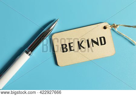 Top View Of Pen And Label Tag Written With Be Kind