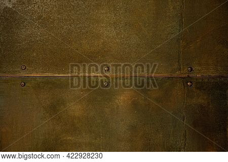Old Metal Rusty Blank Background Plate With Seam And Rivets Close Up