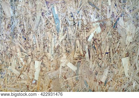 Close-up Texture Of Osb (oriented Strand Board), Rough Surface Of Chipboard Recycled Wood Made By Co